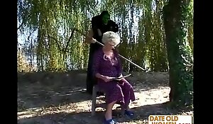 Granny receives a lesson from masked chap