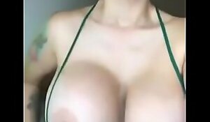 Awesome MILF showing tits and getting wet