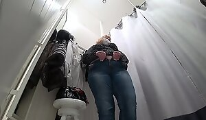 A unventilated camera in a public suiting room, a fat milf disguises herself.