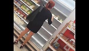 Hot Cougar in high heels shopping voyeur candid