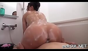 Excited mom with bald pussy takes large cock in mouth