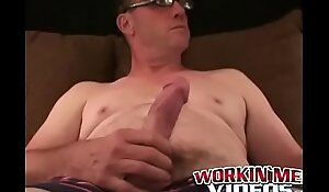 Mature gay man with glasses jerks off his big hard schlong