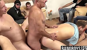Mature dude gets filled while an orgy plays out around him